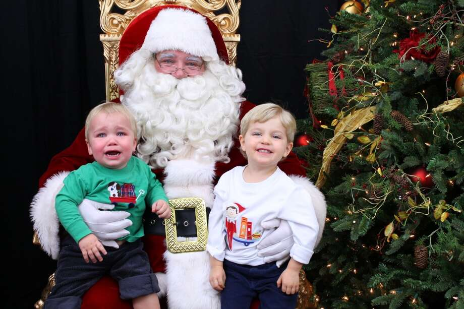 Kalen on the left is the one crying. His brother Kyle knows Santa doesn't like crying. Good stuff!