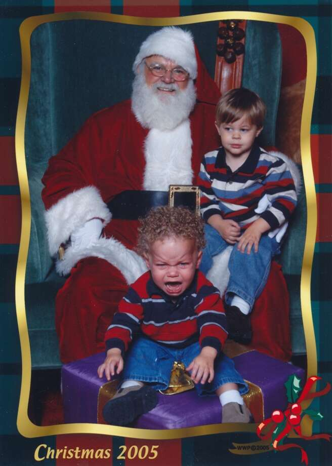 Riley wouldn't sit on Santa's lap so they had to stick him on present in front of him. We thought he was going to pop a blood vessel.  Kristen Ramsey