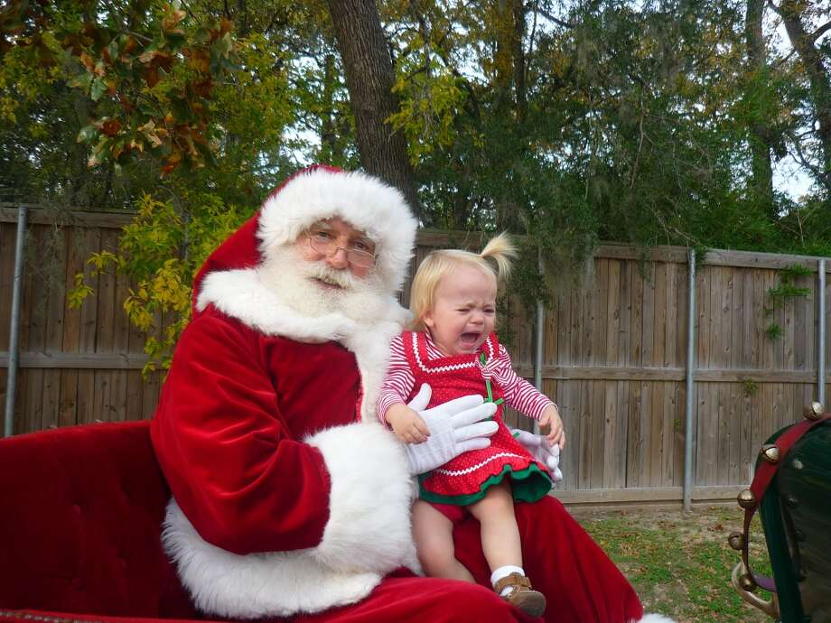 This photo with Santa taken at the Kindell Library in West Houston. Last year my daughter loved Santa, but this year, at 17 months old, it is a completely different story!  Laura Richard
