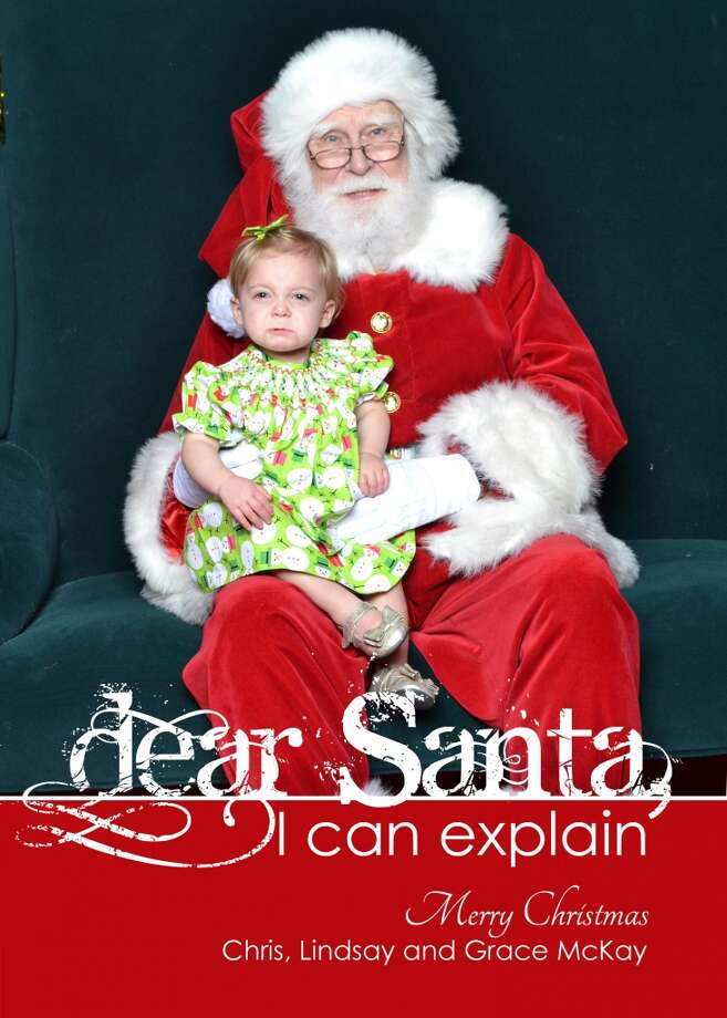 "We took Grace to see Santa. She took some pictures with her Cousin Graham. Once she was by herself with Santa she wasn't happy and gave me this look like ""If you love me you will get me off this mans lap"" ha-ha. She has such a sweet personality and never cries so all that know her think this is the BEST picture! Santa said the crying photos make the best memories!! 
