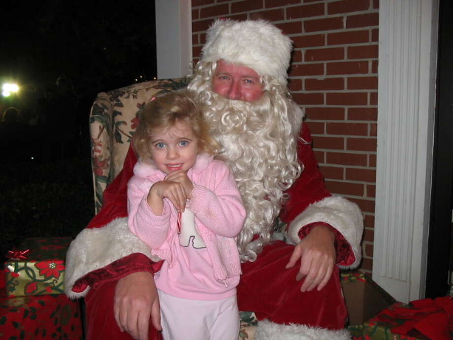 My daughter was all excited to sit on Santa's lap, until it was her turn!