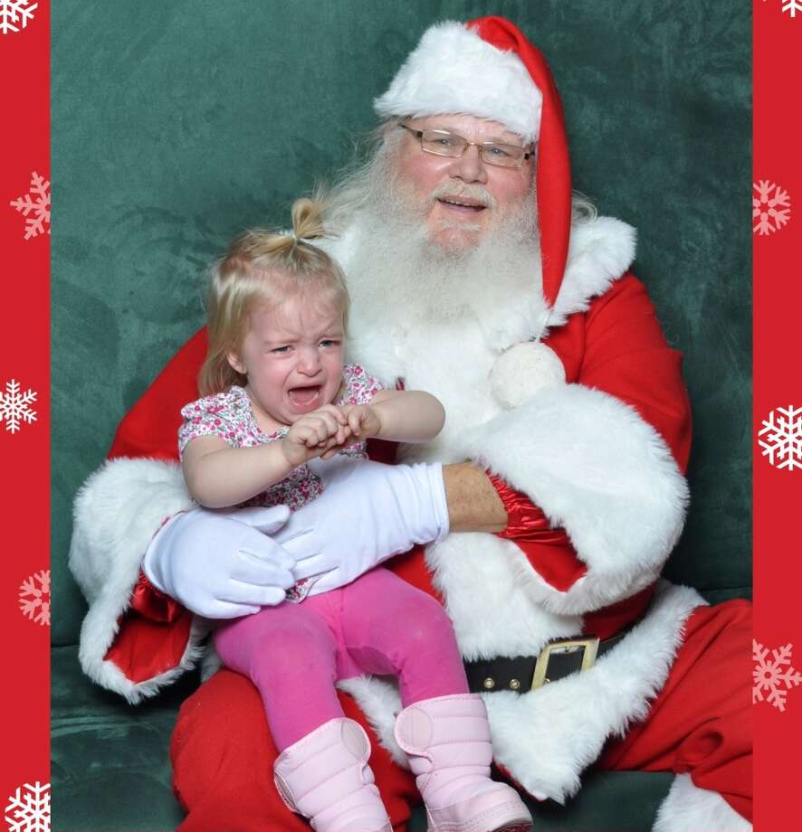 """Ultimately our daughter cried the entire time she was on Santa's lap so we decided that instead of getting the one where she was the most """"okay"""" we would remember it like it really happened and chose the shot where she was the most distraught.  Nathan Salt"""