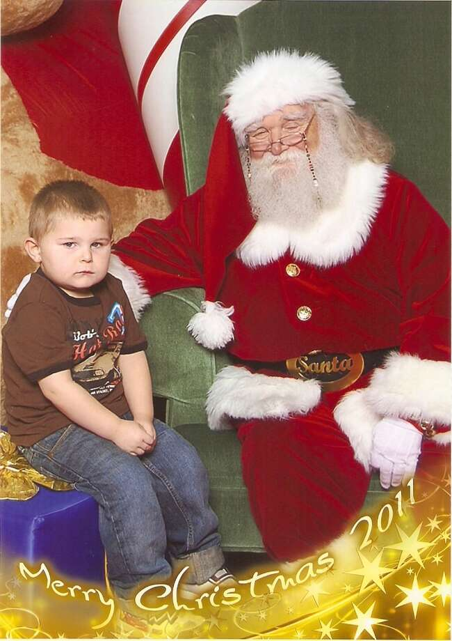 he was happy, laughing and singing the entire time in line to see santa, once he got there, nuh uh, he was not having it, after talkin him into sitting 'next' to santa, this was the best of 5 pics taken...  Patricia Martin