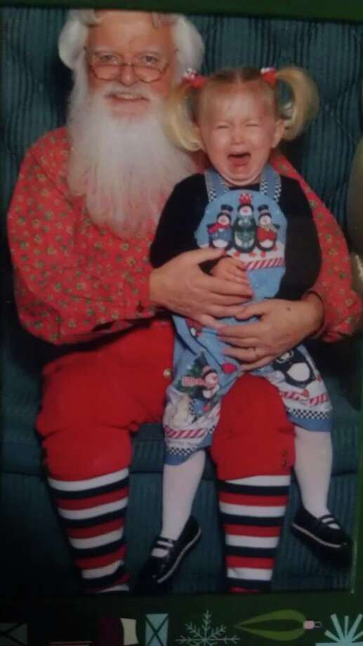 Mackenzie was sos excited about seeing Santa that year. The long line plus the atticipation plus the child in front of her who sort of freaked out made for an unhappy girl. She ended up not a fan Santa that year!