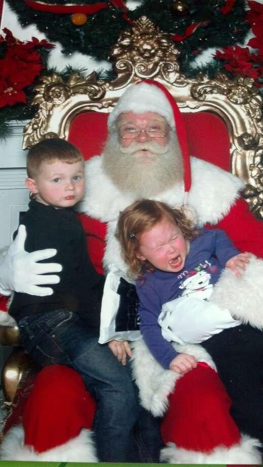 Hunter and Paisley visiting Santa.  Sarah King