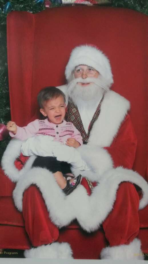 First visit with Santa. 12 months old. Santa doesn't look too happy either...