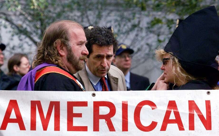The Rev. Jeffrey L. Berry, left, national imperial wizard for the KKK Church of the American Knights, confers with Norman Siegal, center, president of the New York Civil Liberties Union, during a rally outside the State Supreme Court Saturday, Oct. 23, 1999 in New York.  The woman on the right is unidentified. (AP Photo/Mark Lennihan) Photo: AP