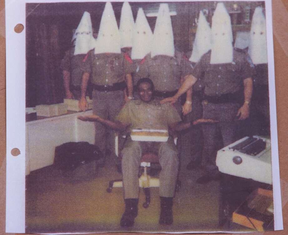CONTACT FILED:  DARRON ANDERSON  Copy photos of pictures provided by the alleged victim Darron Anderson of the office party where as a DPS trooper in 1989  he was greeted by co-workers in KKK outfits...apparently as a joke. He was not amused in spite of the smile in several photos.  HOUCHRON CAPTION (01/06/2000):  Darron Anderson is shown in a 1989 photo with fellow Texas state troopers who were wearing Ku Klux Klan-style hoods at his birthday party.  Though smiling, Anderson said he was not amused.    HOUCHRON CAPTION (01/08/2000):     After seeing photos of a 1984 party in which co-workers donned white hoods like those worn by the KKK, DPS Trooper Darron Anderson, seated, asked for a similar party in 1988, his former supervisor said. Photo: Texas Dept. Of Public Safety