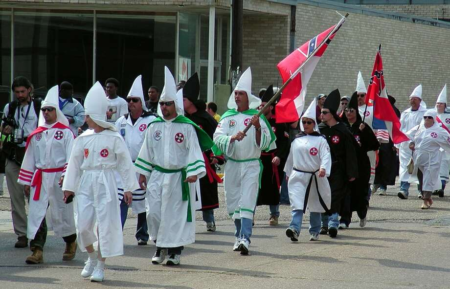 Members of various Ku Klux Klan organizations from Alabama, Florida, Texas and Louisiana marched through downtown Jennings, La., Saturday, April 28, 2001, for a rally in front of the Jennings Public Safety Building. In all, about 40 KKK members marched and held a 40-minute rally. (AP Photo/American Press, Shawn Martin) Photo: AP