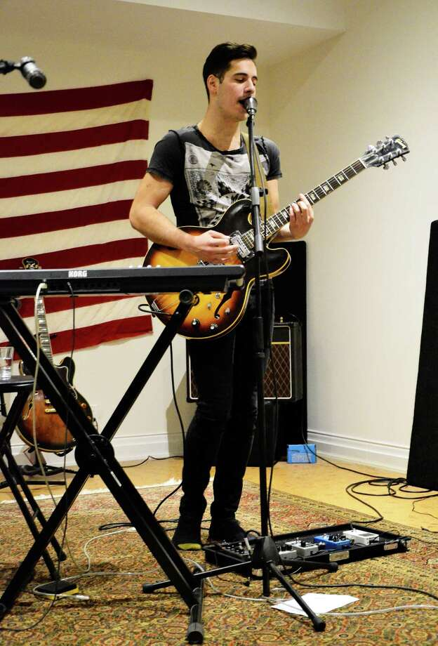 Ula Ruth's Nic James practices at his house in New Canaan, Conn., on Tuesday, Dec. 17, 2013. The lead singer and rhythm guitarist of the Indie rock quartette said he wants to play music for the masses. Photo: Nelson Oliveira / New Canaan News