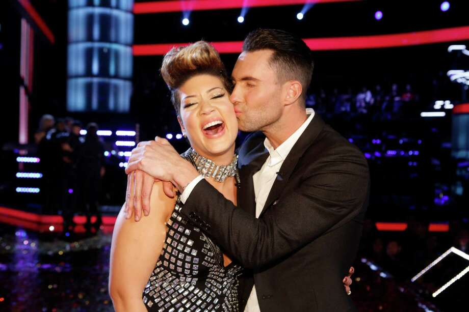 "In this photo provided by NBC, Maroon 5 frontman Adam Levine, right, kisses Tessanne Chin on the cheek after Chin was announced the season five winner of ""The Voice"" on Tuesday, Dec. 17, 2013, in Los Angeles. Chin a 28-year-old Kingston native had nearly given up on her dreams before landing a spot on the NBC singing competition. Levine was Chin's coach. (AP Photo/NBC,Trae Patton) ORG XMIT: NYET207 Photo: Trae Patton / NBC"