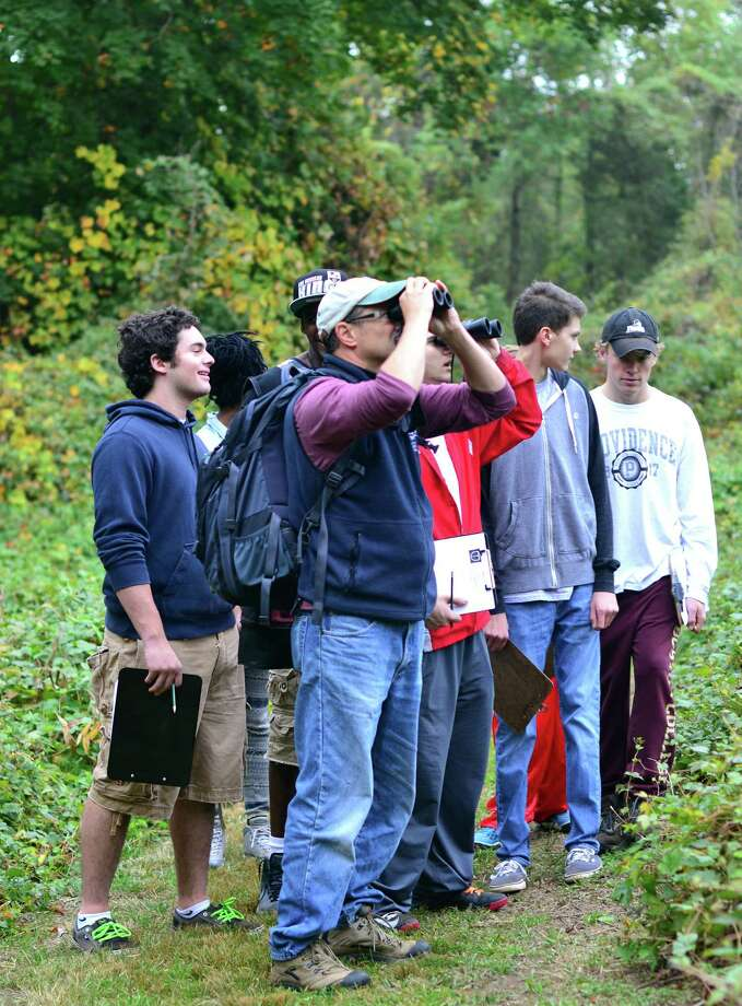 Students at Greens Farms Academy performed field work in October, observing wildlife on Audubon property adjacent to their school. Anthony Zemba, director of conservation services for the Connecticut Audubon, leads the students. Photo: Contributed Photo / Westport News