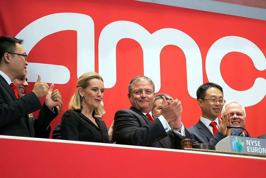 AMC Theaters President and CEO Gerry Lopez (center) celebrates company's IPO. Photo: Ben Hider, Associated Press