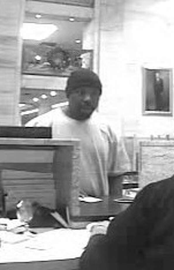 "The FBI has dubbed this suspect ""Ebenezer Scrooge Bandit"" in a Dec. 18 robbery of Chase Bank in downtown Houston."