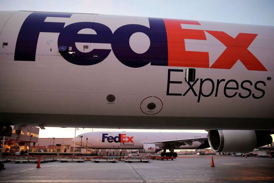 "In this Monday, Dec. 2, 2013, file photo FedEx cargo planes sit on the tarmac outside the FedEx hub at Los Angeles International Airport on Monday, Dec. 2, 2013, in Los Angeles. The CEO of FedEx, Fred Smith, said Wednesday, Dec. 18, 2013, that FedEx has several drone studies underway, but the idea of delivering items by drone is ""almost amusing."" (AP Photo/Jae C. Hong) ORG XMIT: NYBZ142 Photo: Jae C. Hong / AP"