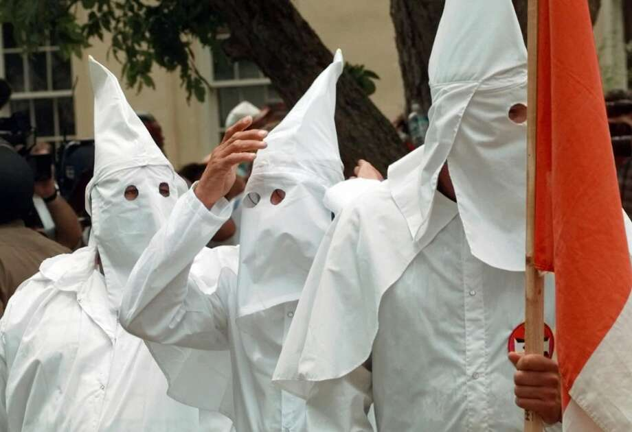 A member of the Ku Klux Klan adjusts his hood during a rally Saturday, June 27, 1998, in Jasper, Texas. The KKK held a rally to denounce the dragging death of James Byrd Jr. Photo: AP