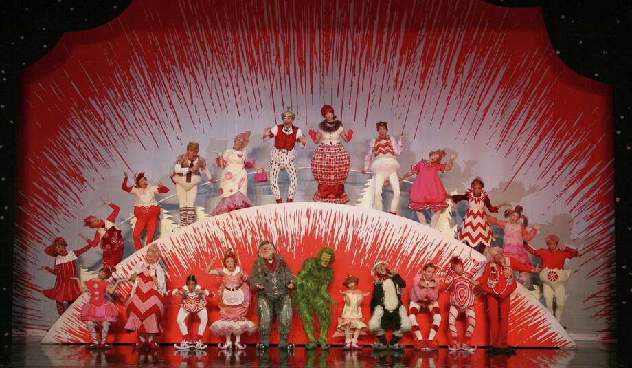 "The Grinch (center, in green) takes on Cindy Lou Who (right of the Grinch) and the rest of Whoville in the stage version  of ""How the Grinch Stole Christmas,"" running Thursday through Dec. 29 at the Majestic Theatre. The musical is an adaptation of Dr. Seuss' 1957 book and the 1966 animated TV special. Photo: Courtesy Photo"
