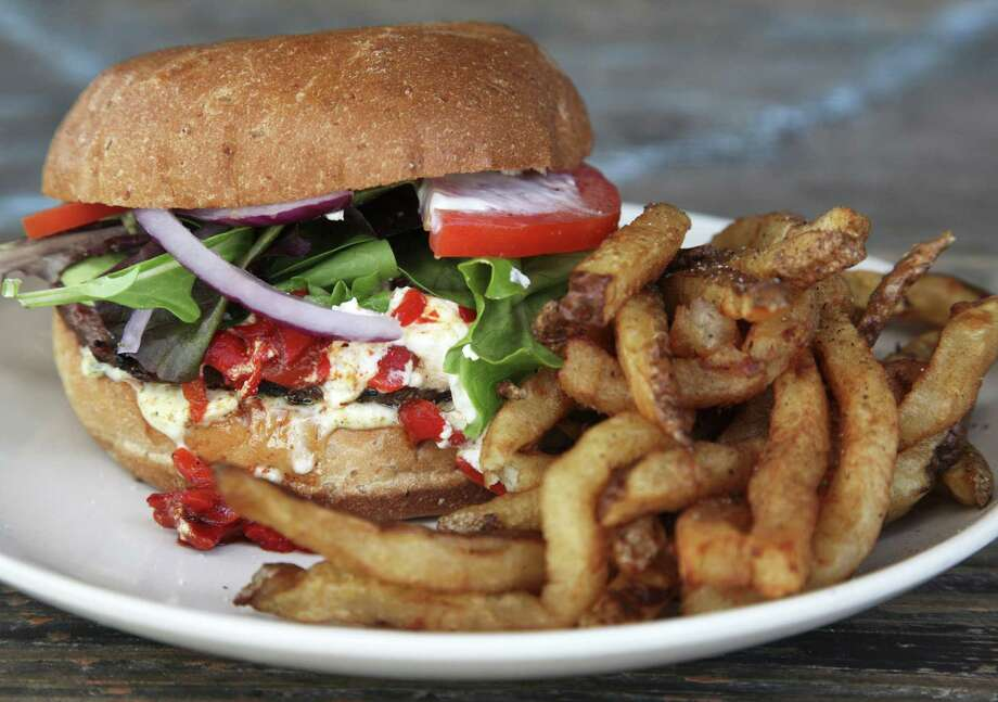 The Cove received a lot of love for its  Texas Burger. Also the 09er Burger (left) is featured there. Photo: Express-News File Photo / SAN ANTONIO EXPRESS-NEWS