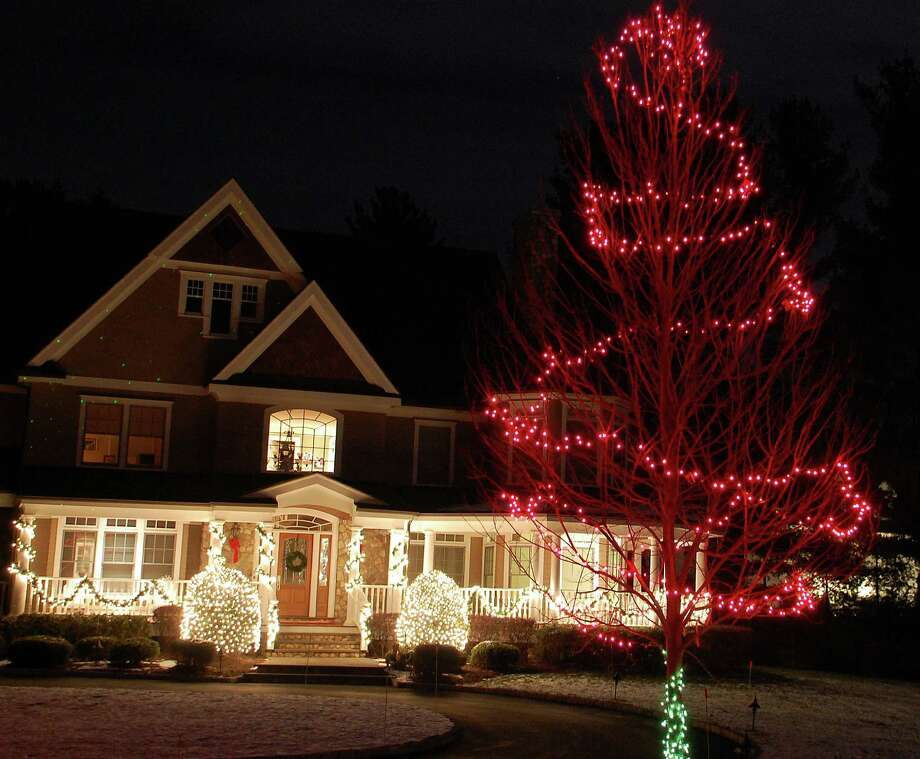 This bright display is lighting the way to the holidays at this Long Lots Road home. Photo: Jarret Liotta / Westport News contributed