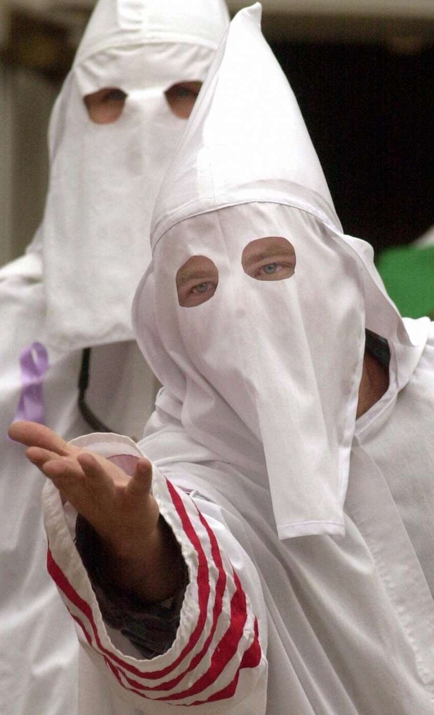 A member of the Ku Klux Klan taunts the crowd during a rally on the steps of the Cumberland County Courthouse in downtown Carlisle, Pa., Saturday, Sept. 23, 2000.(AP Photo/Chris Knight)