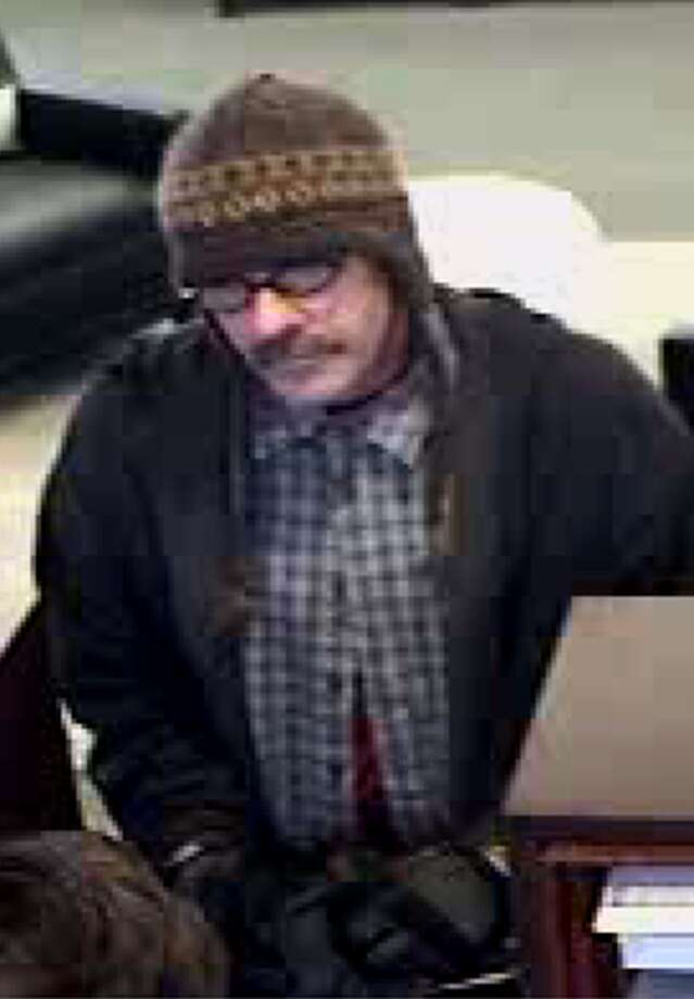 """Police said Christopher Wootton, 60, of Larkspur has now been identified as the man who robbed at least three banks in Marin County over the past year. Wootton, seen here in surveillance tape from a bank, gained the moniker """"Cotton Ball Bandit"""" after appearing in a hat in several robberies."""