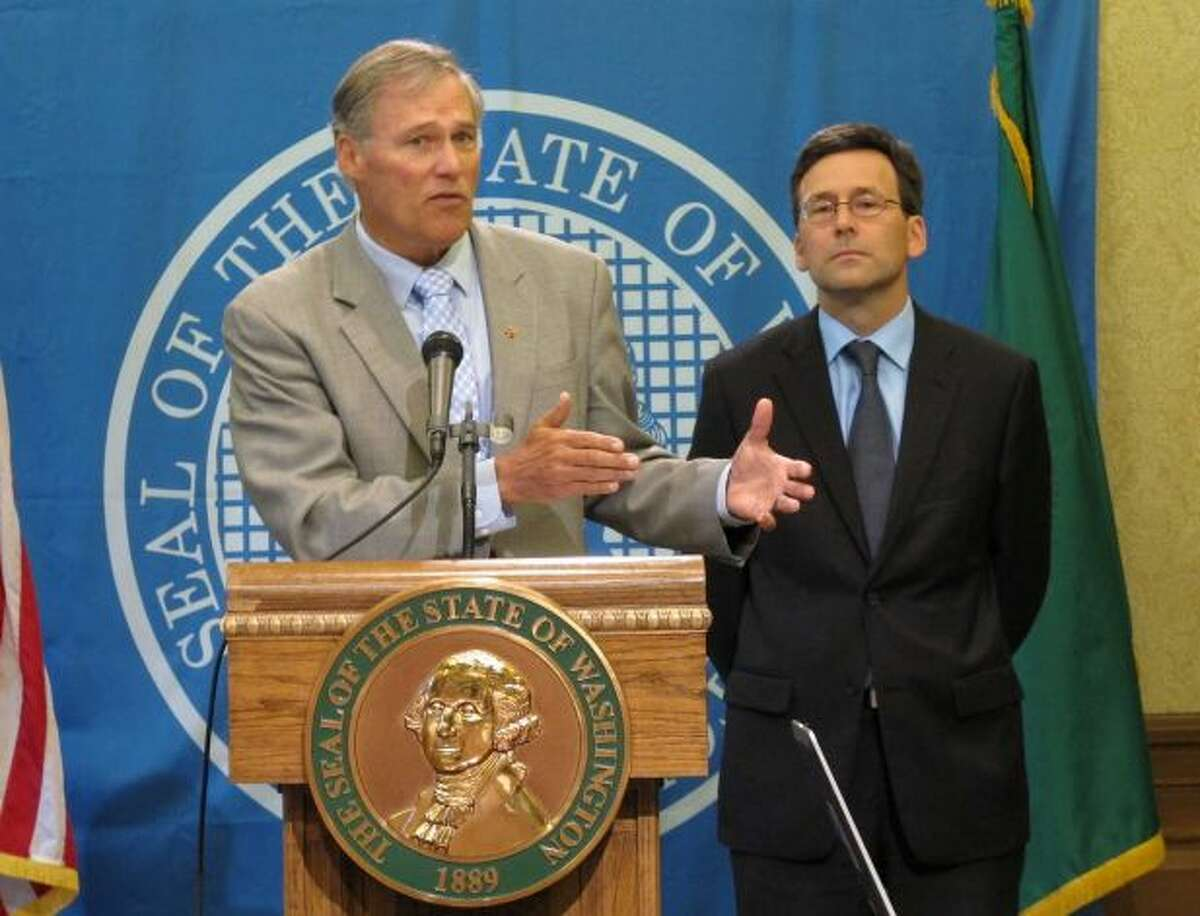 Attorney General Bob Ferguson, right, with Gov. Jay Inslee.  Ferguson is top prospect to succeed Inslee if the Governor does not seek a third term.  Washington has only once, in its 130 year history, elected a Governor to three consecutive terms.