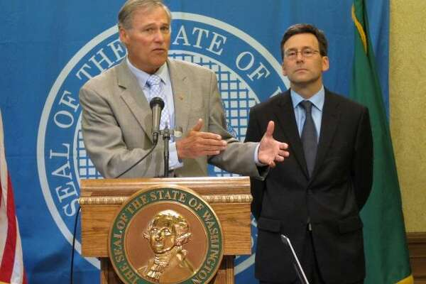 Attorney General Bob Ferguson, right, is a rookie state official, but has scoped out moves like the chess champion he is. Ferguson has reached an accord with the feds over our marijuana initiative, challenged the U.S. Department of Energy on Hanford's leaky radioactive waste tanks, and sued a Richland florist who refused to provide flowers to a gay wedding.    Ferguson mounted a sustained legal challenge to the powerful Grocery Manufacturers Association, which flaunted Washington's voter-approved public disclosure laws and hid the source of millions spent to fight a food labeling initiative. Look for a hefty fine in the new year.