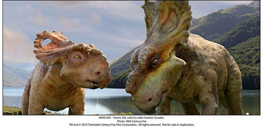 "Patchi (Justin Long) with older brother Scowler (Skyler Stone) stop to gab in ""Walking With Dinosaurs."" Photo: Twentieth Century Fox"