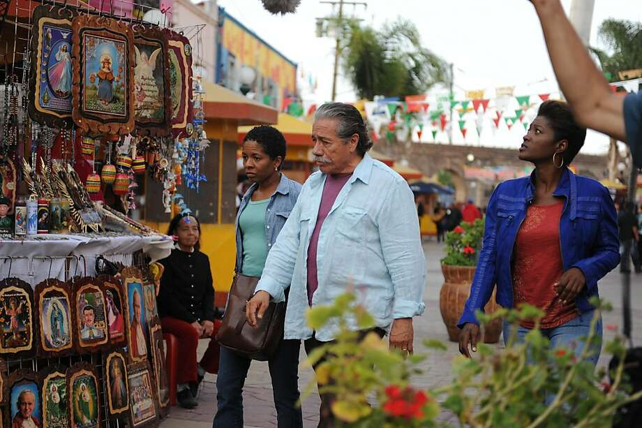 "Bernice (LisaGay Hamilton) and Freddy (Edward James Olmos) navigate Tijuana's Chinatown in ""Go for Sisters."" Photo: John CastilloJohn Castillo), Variance Films"