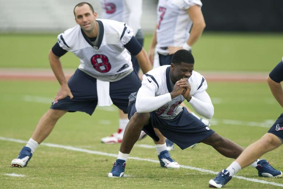 Schaub and wide receiver Andre Johnson (80) stretch during practice a few days after the sideline confrontation. Photo: Brett Coomer, Houston Chronicle