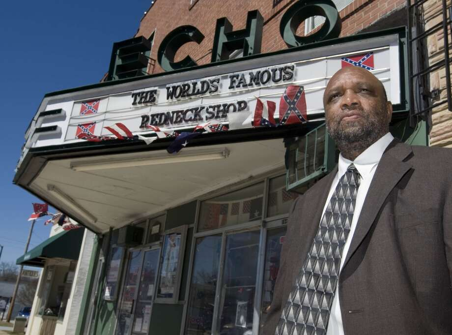 FILE - In a Wednesday, Feb. 27, 2008 file photo, Rev. David Kennedy, pastor of New Beginnings Baptist Church, stands outside The Redneck Shop in Laurens, S.C. A judge has ruled that the New Beginnings Baptist Church is the rightful owner of the building where The Redneck Shop is located.  New Beginnings sued John Howard and others in 2008, saying the property was transferred to the church in 1997 by a Klansman fighting with others inside the hate group.(AP Photo/Patrick Collard, File) Photo: Associated Press