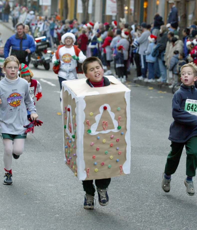 These days, kids are more apt to dress up as cookies (or gingerbread) and do the Jingle Bell Run, a festive tradition. Pictured is Taylor Schwartzenberger, 11, running toward the finish line on Dec. 8, 2002.  Photo: GILBERT W. ARIAS, -