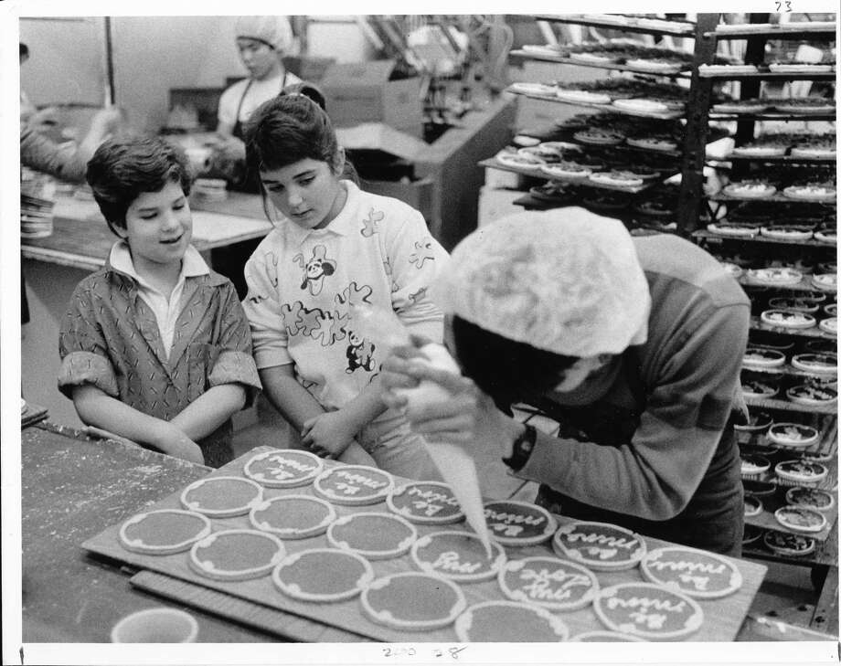 Kids could tour the Baders' Dutch Biscuit Co. factory, known for its tins of shortbread cookies, especially popular around the holidays. Alison Golub and Sarah Diers watch a baker at the company, likely circa 1980s.  Photo: -