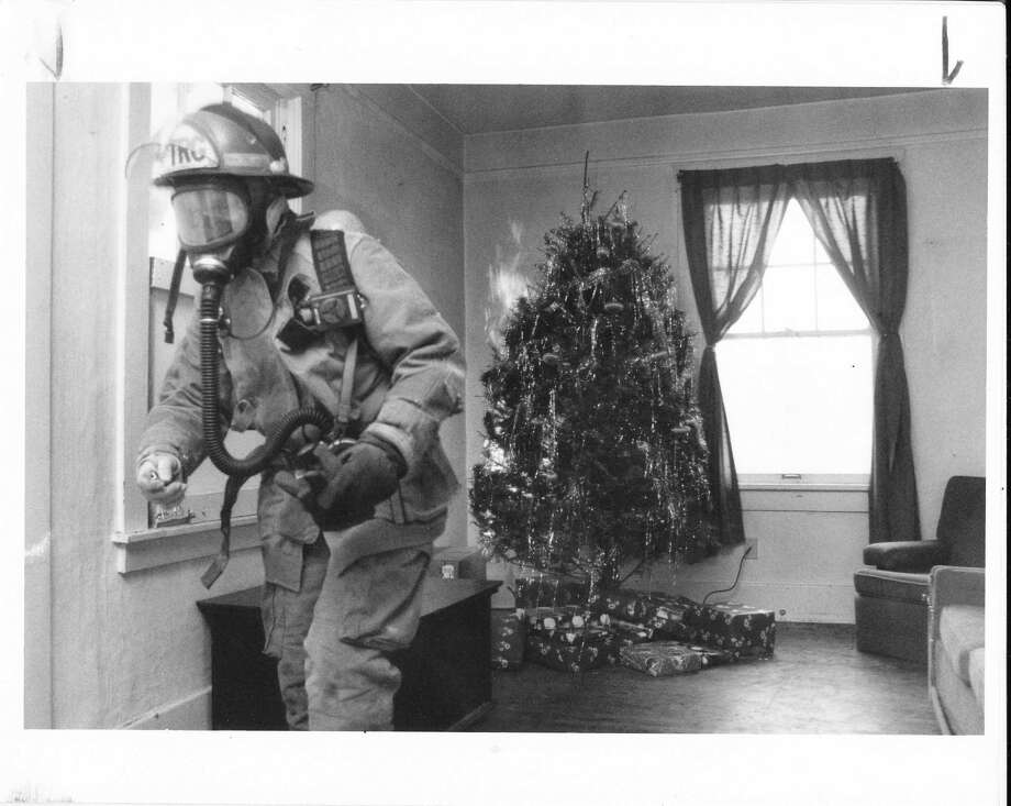 Christmas trees were the subject of abuse from Seattle firefighters, who used to light them on fire to demonstrate the importance of fire safety and watering your tree. (Photo: Dec. 11, 1992) Photo: -
