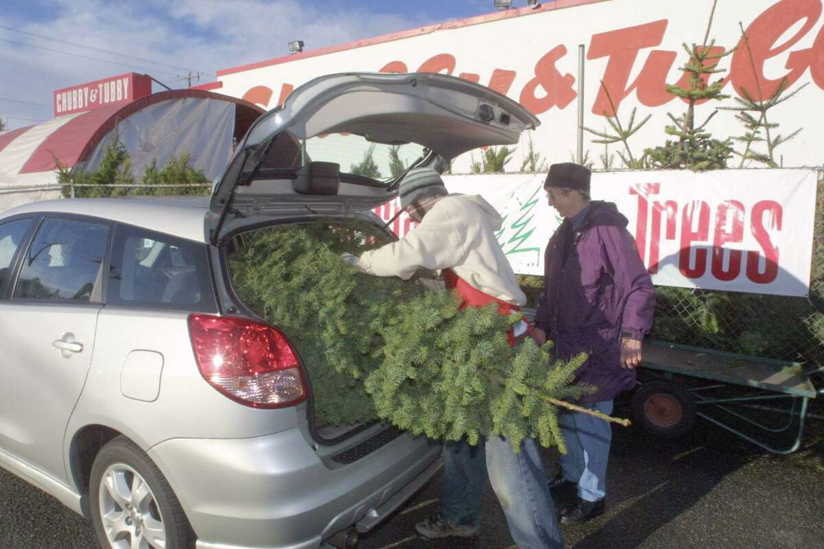 Chubby and Tubby store on Aurora Ave. loads a Noble Fir tree for Gerda Newsheller that she bought for $l7.99 on 12/16/02.