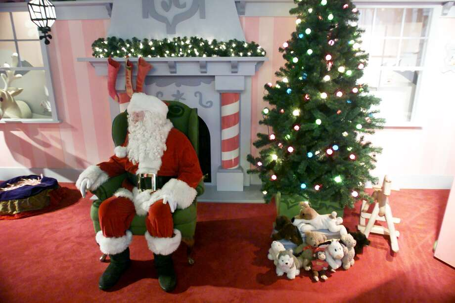 These days, Santa has it pretty easy as he waits for kids inside a heated living room. (Nordstrom, downtown Seattle) Photo: MARK SOBHANI, -