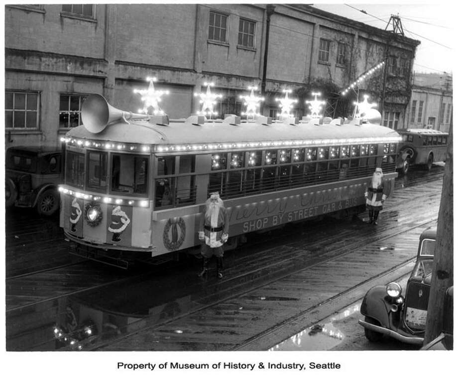 It took two Santas to run this street car in Seattle in 1936.  Photo: -