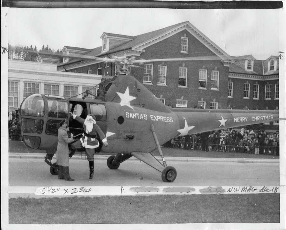 Who needs the sleigh when you've got a military helicopter? Santa arrives at Sand Point Naval Air Station in Seattle on Dec. 16, 1948.  Photo: -