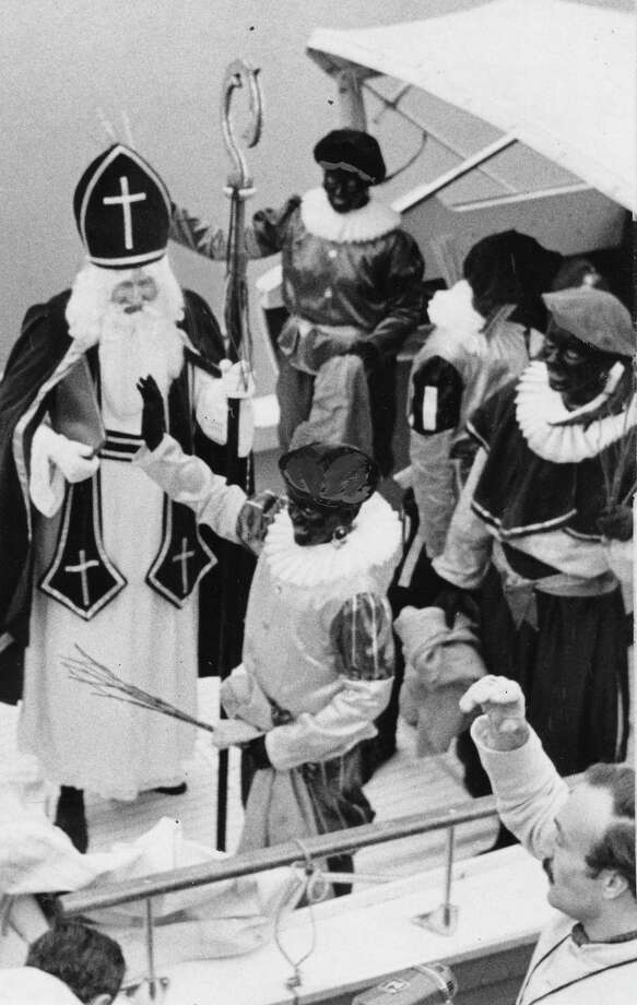 "Before you lapse into nostalgia, some things are better left in the past. Like this 1968 event at the Shilshole Marina, of ""Sinterklass,"" or Dutch St. Nicholas, and his tradition of bestowing presents with blackfaced helpers called ""Black Petes.""  Photo: -"