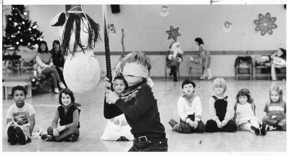 A snowman gets whacked in the '80s. (Photo: Tyler Babcock, 5, is pictured on Dec. 19, 1982 at the Alki Community Center) Photo: -