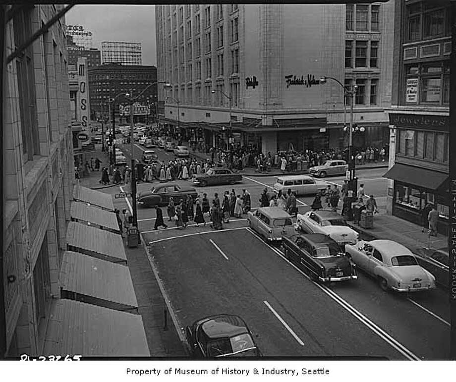 For generations, one department store epitomized holiday shopping in Seattle: Frederick & Nelson. Famous for its tearoom and Frango chocolates, F&N moved into the corner of Fifth and Pine in 1918 and went out of business in 1992. It's pictured in the background in 1954.  Photo: -