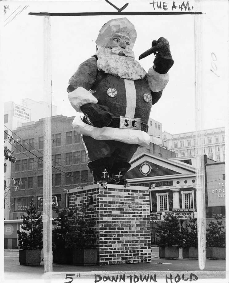It was this 42-foot, pipe-smoking Santa, who came out every Christmas on Westlake Avenue, from roughly the '60s to '70s.  Photo: Nov. 25, 1973. Photo: -