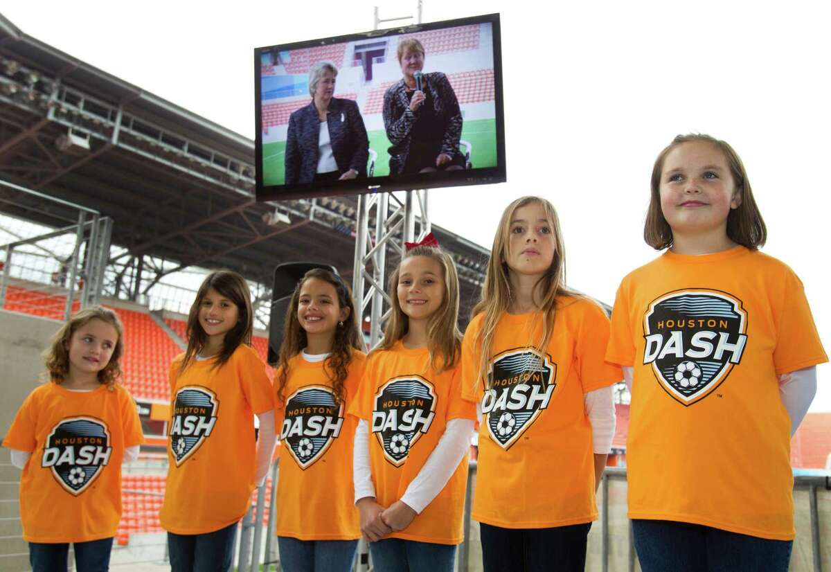 Houston Mayor Annise Parker, left, and Cheryl Bailey, executive director of the National Women's Soccer League, are shown on a video monitor during a news conference announcing the naming of the Houston Dash as the newest team to the NWSL at BBVA Compass Stadium Thursday, Dec. 12, 2013, in Houston. The Dash will begin play in the spring of 2014 of the 9-team league with a 24-game schedule. The team will be owned and operated by the Dynamo of Major League Soccer. ( Brett Coomer / Houston Chronicle )