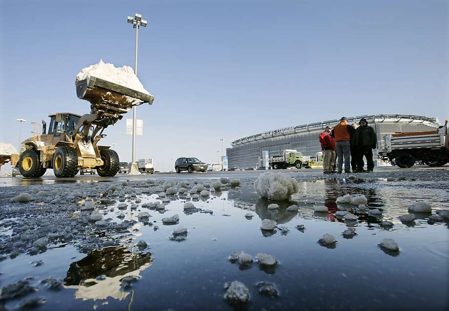Snow is removed outside MetLife Stadium, where the Super Bowl will be played Feb. 2. Photo: Mel Evans, Associated Press