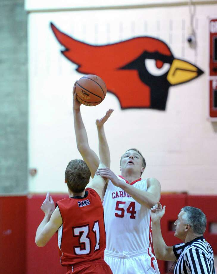 At left, New Canaan's Andrew Penchuk (# 31) jumps center against Alex Wolf (# 54) of Greenwich during the boys varsity basketball game between Greenwich High School and New Canaan High School at Greenwich, Wednesday night, Dec. 18, 2013. Photo: Bob Luckey / Greenwich Time