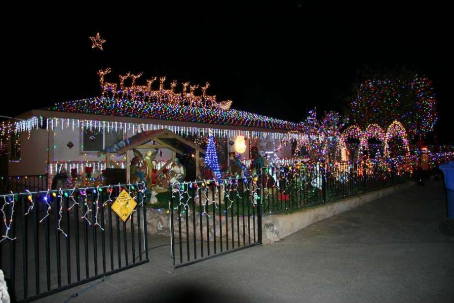 2192 Penny Ln. Napa, Napa County, 94559 - Burning enough lights (30,000 plus!) to power Paris for a month, this house has every conceivable element in a dense, blinding display. They also have a life size Mr. & Mrs. Claus that stands in front of their front door (animated). They are out every night except when it rains. A 17-year tradition at this address. Speakers are mounted around the property with piped-in music. Photo: Lightsofthevalley.com
