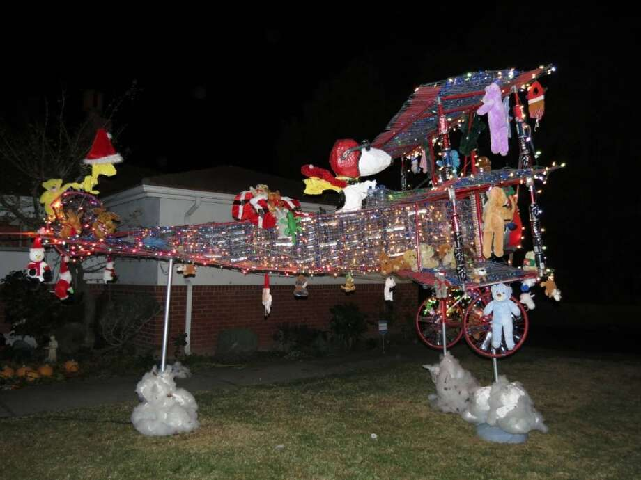 975 Estudillo Ave San Leandro, Alameda County, 94577 - Snoopy on a mission to deliver toys for Christmas. This home made triplane is made out entirely of recycable materials like chicken wire and paper mache. It contains about 750 empty water bottles. Photo: Lightsofthevalley.com