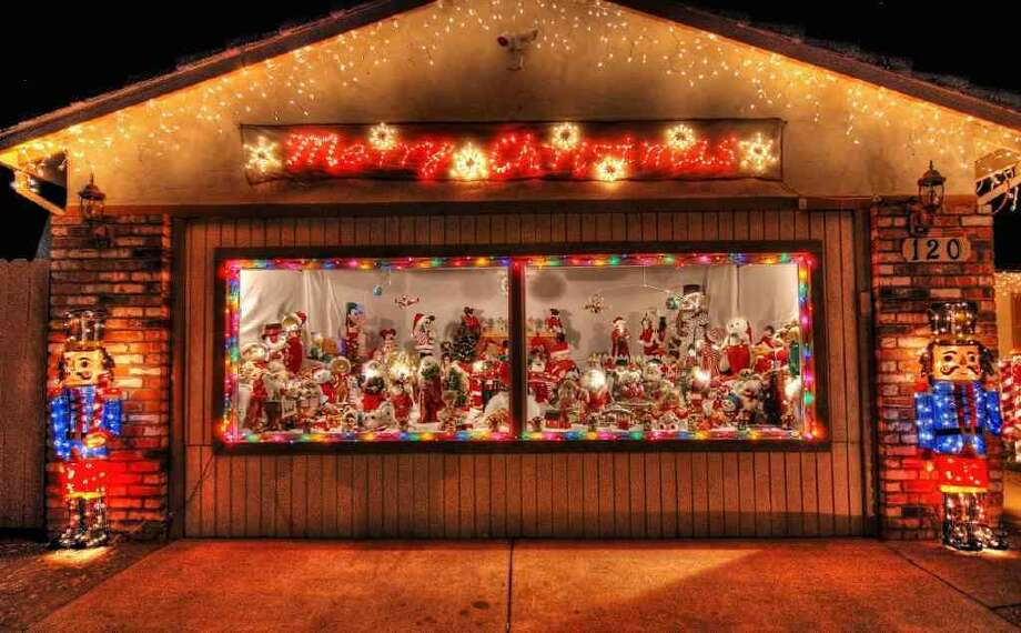 120 Benedict Ct. Martinez, Contra Costa County, 94553 - The window display at this house consists of animated figures the owner has been collecting for years.  The yard display has a merry-go-round, a Ferris wheel and numerous other lighted figures. Photo: Lightsofthevalley.com
