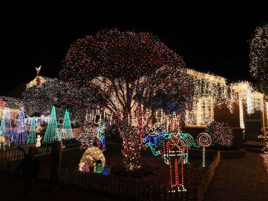 1963 Eucalyptus Ave. San Carlos, San Mateo County, 94070 - This house is one of many creating a walking neighborhood display. For two blocks, neighbors decorate their houses, making for a nice holiday stroll, especially on weekends when many homeowners sit outside their homes and explain their displays to visitors. Photo: Lightsofthevalley.com