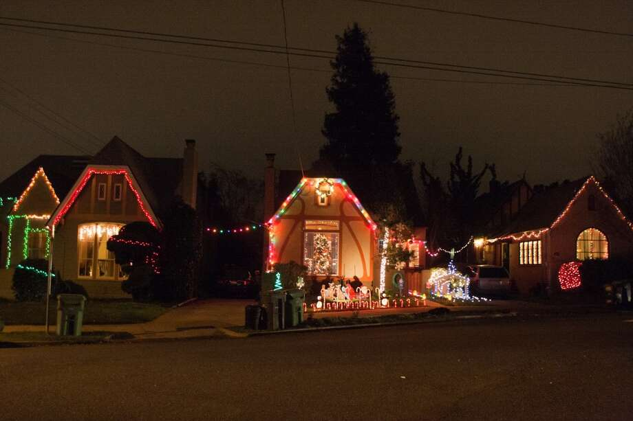 Picardy Drive, Oakland, Alameda County, 94605 - The hundred or so residents of Picardy Drive in East Oakland illuminate their Tudor-style houses with an unbroken string of lights, in a holiday tradition that dates back nearly 80 years. The display is meant to symbolize warmth, friendship and unity. Photo: Douglas Zimmerman, SF Gate